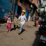 kids walking down the street in dharavi