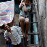Dharavi tour: child playing on stairs