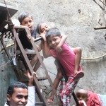 Kids playing on stairs, Dharavi tour in Mumbai